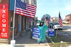 Main Street, Clarion, PA. Does Miss Liberty want you to pay your taxes or take out a loan? Photo by Ron Wilshire.