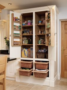 Our fitted larders are made to suit any layout and come with a variety of different storage ideas. Choose from herb racks, bottle or wine racks, sliding wicker baskets, bread drawers and adjustable wooden or glass shelving.  Shown right is a Fitted Larder painted in cream with sliding wicker baskets and herb racks.
