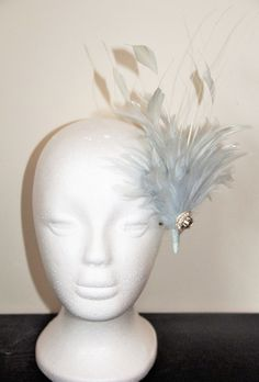 This is a pretty handmade 1920s/Great Gatsby style barrette hair clip with a gorgeous large pale blue feather. The hair clip is decorated with beautiful hand stitched swarovski crystal detailing and pale blue arrow feathers.  This would be perfect for a wedding, the races or a party!  There is currently 1 item in stock, which can be shipped within 1 - 2 business days. However, if you would like more than 1 item, please allow 1 - 2 weeks.