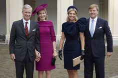 Royals as fashion icons: blue for the Netherlands, purple-burgundy for Belgium.