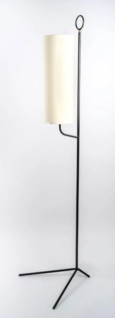 For Sale on 1stDibs - Pair of Maison Lunel floor lamps from the 1950s Composed of a central rod of round section in black wrought iron resting on a very original base, composed Standard Lamps, Floor Lamps, Wrought Iron, 1950s, Pairs, Shades, Base, Flooring, The Originals
