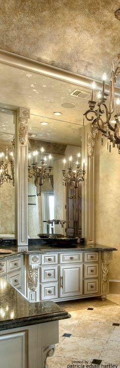 Glamorous bathroom.  Exquisite fixtures and beautiful paint finish on the cabinetry, walls and ceiling.