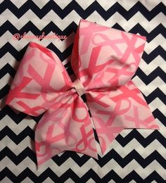 """This+3""""very+cute+cheer+bow+is+made+of+pink+ribbon+fabric.+It+is+attached+to+a+ponytail+holder.+Perfect+for+cheerleading,+softball,+dance,+soccer,+etc.+You+would+see+this+bow+at+an+allstar+cheer+competition.  October+is+breast+cancer+awareness+month.  This+bow+is+perfect+for+pink+out+games.    Thi..."""