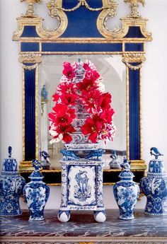Blue and white porcelain with red and white parrot tulips - Simple, but elegant design by Carolyne Roehm
