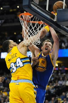 JaVale McGee, left, blocks a shot by Golden State Warriors forward David Lee, right, in the second quarter of Game 1 in the Quarterfinals  of the NBA basketball playoffs on Saturday, April 20, 2013, in Denver.