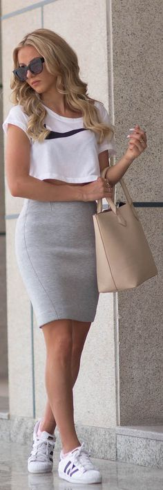 Sendi Skopljak is wearing a white crop top from Nike, grey skirt from Gina Tricot, shoes from Adidas and the tan bag is from Bershka