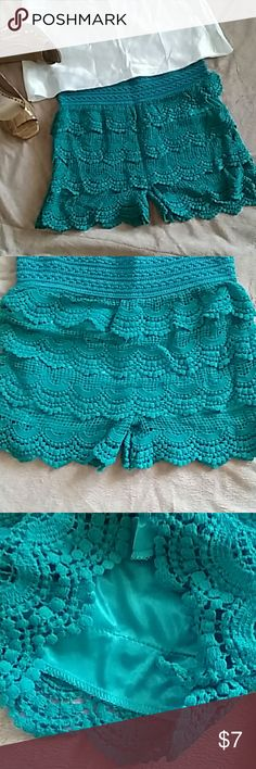 Lace shorts Emerald /tealgreen lacey shorts. Never worn. No tag. Bought as a medium. Has a satin underlings. Cam be worn as such or intimates. Bundle and save! Make an offer. Shorts