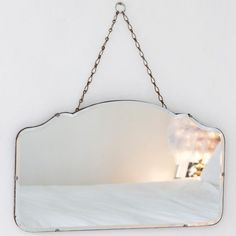 Vintage Scalloped Mirror from The Other Duckling. This pretty vintage frameless mirror is a gorgeous shape & comes complete with it's original hanging chain