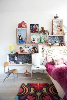 arrange a selection of wall mounted old wooden crates with vintage wallpaper or wrapping paper to display your favourite things (via the boo and the boy: Eclectic kids' rooms)