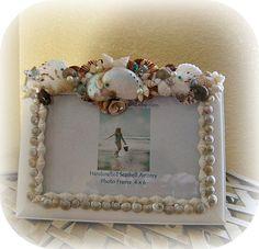 The Beach Getaway seashell frame by SuziesSeashellWorld on Etsy, $39.00