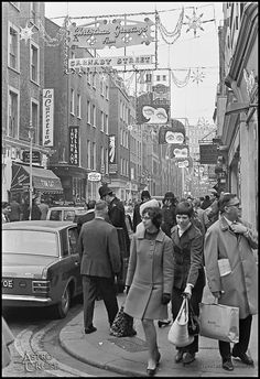 "Carnaby Street 1960's - ""How constantly and overwhelmingly the advertisements, radios, newspapers and movies play on us! But in thinking of them remember that to them they are tokens of mockery. These bright colors may fill our hearts with elation, but to many they are daily taunts. Imagine a man walking amid such a scene, a part of it, and yet knowing that it is not for him."" - Max, 'Native Son'"