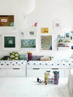 rustic white wood flooring, white walls, white benches with storage underneath for the kids space. EMMA PERSSON LAGERBERG'S HOME