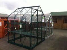 UK Garden Buildings are growing steadily and as they open new sites, we spread with them!  These display greenhouses were installed at the Burton show site in February 2012.