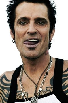 TOMMY LEE  - Beautiful Smile, tall, dark hair.  Not a big tattoo fan, but his don't really show do they? ; )