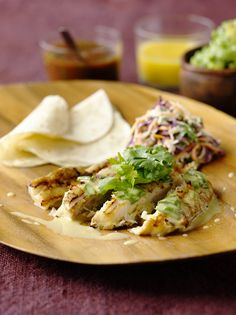 Red Snapper with cabbage slaw, salsas, and flour tortillas.  A healthy fish taco from the kitchen of Bobby Flay.