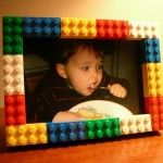 Lego picture frame. It took 20 minutes to build, and the geometry worked out nicely. Who knew that a 3 x 5 photo would fit perfectly in a 13 x 18 dot Lego grid? It was meant to be. Some flat rectangles as the base, an inner border of thin 1 x 4 and 1 x 6 pieces, and the photo is held in place by the bricks on the front.