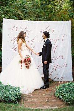 Pick up a set of sheets or a tablecloth from the dollar store, and ask a friend who's good at calligraphy to write a meaningful quote or one of your vows on the sheet. This is such an easy way to add a personalized touch to your wedding for very little money!