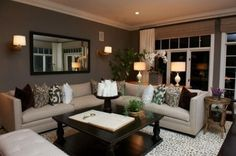 Brown walls with colorful neutral throw pillows