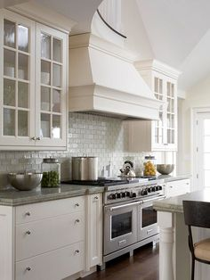 Soaring ceilings, simple Shaker-style cabinetry, and column details on the 12-foot-long islands are testaments to this kitchen's spacious size and beautiful craftsmanship.