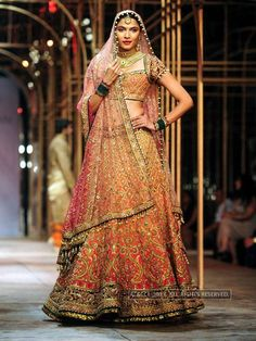 Model Hemangi walks the ramp for designer Tarun Tahiliani during India Bridal Fashion Week '13, held at Grand Hyatt, in Mumbai, on November 29, 2013.