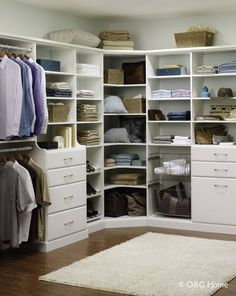 Walk in closet with corner shelving. Great organization!!