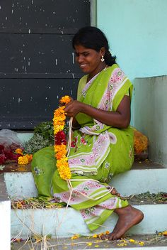 Making garlands for offerings to the gods or for weddings or in fact any event, is a daily task for many women.in #India
