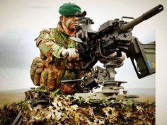 Royal Marine commando manning a 30 caliber HMG