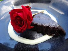 Chocolate cake and a red rose with vanilla custard