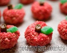 An apple for the teacher! Tootsie roll and spearmint leaf with a ball of rice krispies treats dyed red.