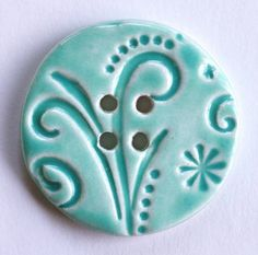 Ceramic Button - Huh, never though of making buttons with clay.  Clever.