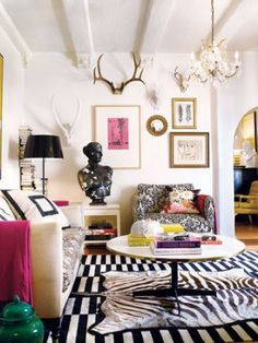 Minus the zebra rug on top of the SUPER AWESOME RUG, me likey.