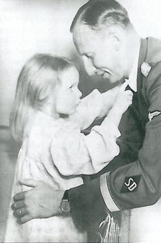 Reinhard Heydrich shares a tender moment with his daughter Silke.