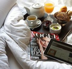 good morning! Breakfast in bed, magazine and computer. I may never leave my bed.