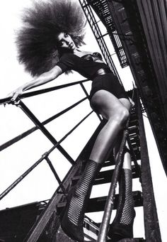 Photo: Mario Sorrenti | fashion editorial | afro | legs | posing | bridge | ladder | stairs