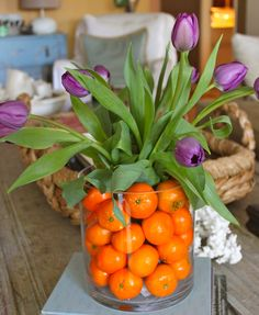 purple tulips and clementines make a happy floral centerpiece. -m