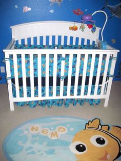 """Finding Nemo Nursery, We picked this design because my husband was in the military and every time he would go out to sea I would tell him to """"Find Nemo"""" for me.  Nemo has always been apart of our relationship and the meaning of it helped us stay together while he went underway.  , We made the bumpers for the room because I looked everywhere and I mean everywhere for a finding nemo theme and could not find one or they were well over $300  , Nurseries Design"""