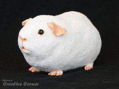 Guinea pig sculpture made of polymer clay from Etsy: https://www.etsy.com/dk-en/listing/180942349/your-own-custom-guinea-pig-sculpture?