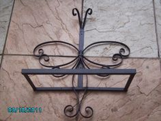 Butterfly bird feeder. One of the many wrought iron designs that Jim makes