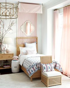 Blush pink bedroom with wicker bed designed by Suzanne Kasler for Ballard Designs