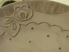 Like the idea of using applique rather than stamping into clay