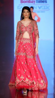 The 'Gulabi Noor' Trail ShararaAccommodating a broad selection of modern and jewel-tones like fuchsia pink, the trail sharara exudes an air of luxury and flamboyance. Playfully sinuous french-knots, splashed sequins, shimmering Moroccan motifs and traditional embroideries grace this marvelous ensemble. Sharara, Anarkali, Lehenga, Heavy Dresses, Formal Dresses, Designer Wear, Designer Dresses, Wedding Saree Blouse, Sequins