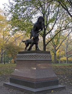 'Indian Hunter'  Statue by John Quincy Adams Ward -- Central Park, New York City, New York      This 1866 bronze statue of an 'Indian Hunter' by John Quincy Adams Ward (1830-1910) sits west of Literary Walk. A Native American hunter, bow in hand, restrains his snarling hunting dog. Cast in 1866 and dedicated on Feb. 4, 1869, the statue was the first sculpture by an American artist to be placed in Central Park, and is one of the oldest works on outdoor display in the park.