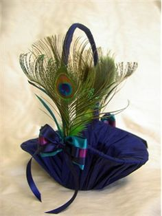 Oh my goodness, I hadn't even thought of a peacock flower girl basket! Could totally DIY
