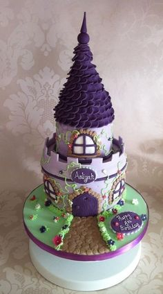 Girly Castle cake with a Tangled feel!  Cake by SugarMummyCupcakes