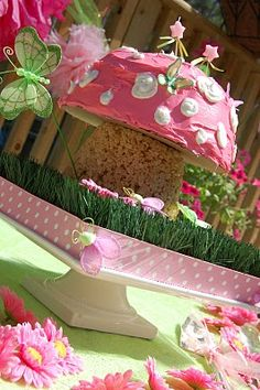 The perfect Cake for a fairy party! A pink polka dot mushroom. Strawberry Bundt cake with a rice krispie treat bottom. @marcy grauer