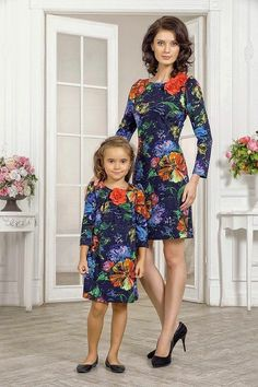 """Mommy and I show off our new dresses, which we will wear to church on Sundays."""
