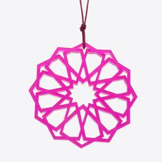 Laser cut plexiglas pendulum with recurring geometric shapes. Magda Tammam's collection West East Arabesque, influenced by Islamic art as well as by Goethe's poems West-östlicher Divan, which were in turn inspired by the Persian poet Hafez, is a translation of archetypal patterns into jewelry.