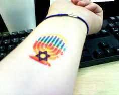 Tattoo of a menorah and a star of david.  This Jew celebrates Hanukkah all year round!  Candles lit and everything!