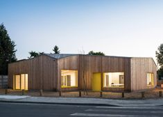 Faceted timber community centre completed by Gayet-Roger Architects