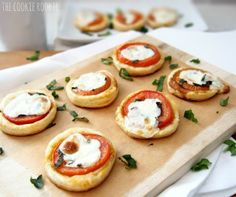 caprese tarts made with tomato, balsamic, basil, and mozzarella.  all on a bed of puff pastry.  AMAZING.